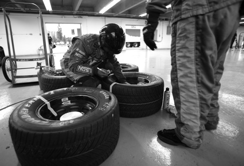 Kris the tire specialist preparing the Goodyear Rain tires